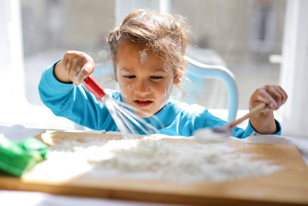 Canva - Girl Wearing Blue Top While Playing With Flour